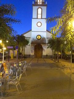 The quaint local church at night