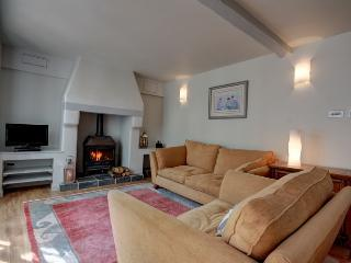 Comfortable sitting room with wood burning stove