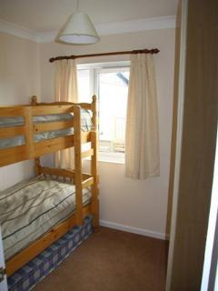 Bedroom three contains a set of bunk beds with 5'9' matresses.