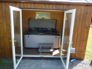luxury hot tub on site with patio area, suitable for upto six people,