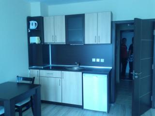 Fully fitted kitchen with built in electric hob, fridge and numerous kitchen accessories