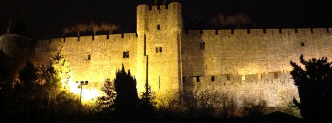 A view of the castle walls at night, taken from first-storey bedroom window.