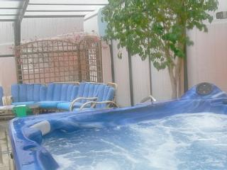 Relax and unwind in the seven seater hot tub with cd player