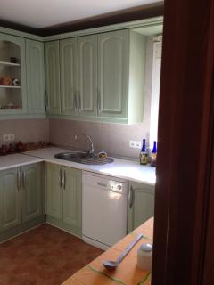 Kitchen with natural light. Dishwasher, Washing Machine. Table to sit for breakfast.