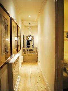 Hallway in your accommodation with original art on walls