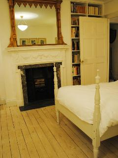 Georgian fireplace and view of bookshelf