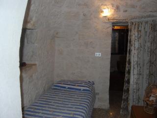 single bedroom in the trullo