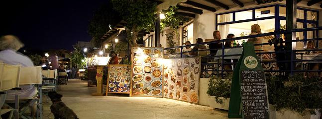 beachfront promenade in makrygialos - fantastic restaurants and bars - under the stars