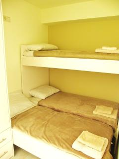 Second bedroom - showing double bed and single bunk formation