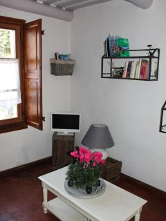 First floor, living room with book, journal, magazines and television