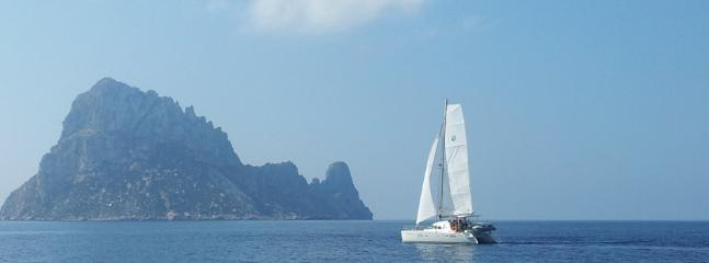our catamaran sailing off the coast of Ibiza