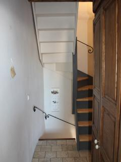 Stairs leading to 3rd level. Large cupboard on the right.