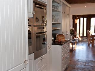 View along kitchen to dining area