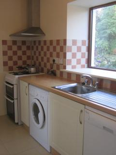 Kitchen with gas oven/hob, washer/dryer, dishwasher, fridge/freezer