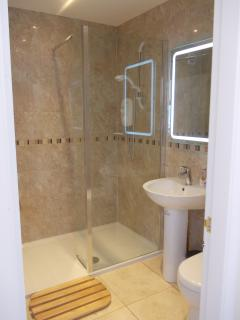 One of the 6 shower rooms, with walk-in shower and heated mirror