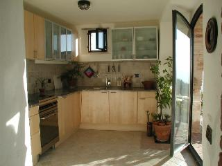 fully equipped kitchen leading to terrace