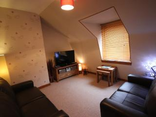 The lounge with HD TV, stereo and DVD Player