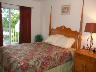 Upstairs Queen bedroom with waterfront balcony and awesome waterfront view.