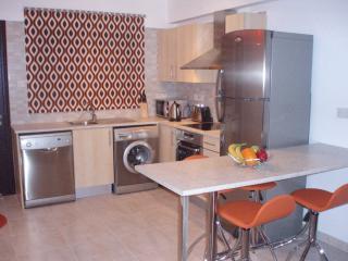 Kitchen and Dining Area.  Note dishwasher, washing machine, oven and hob, fridge freezer