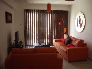 Sitting Area with flat screen TV.  3 seater sofa acts as a double bed if required.