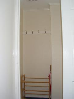 The hallway between lounge, twin bedroom and bathroom. Shoe rack and  umbrella provided for you.