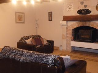 lounge with cosy log burning fire, large 3 seater and 2 seater settees.