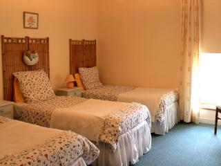Second bedroom with 3 single beds and en-suite shower room and wc