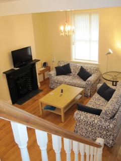 The spacious open plan living room provides comfortable living and relaxation space.