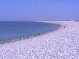 Chesil Beach is an 18 mile long pebble beach that extends from Portland to West Bay in Dorset.