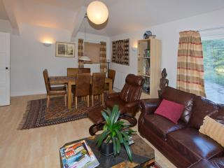 The large and comfortable lounge/diner with large screen TV, DVDs and games for those wet days