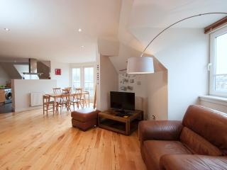 The lounge is open plan with the dining area and kitchen.