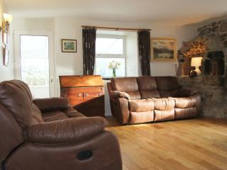 Sitting room with seating for 8 including two 3 seater recliner sofas and two arm chairs