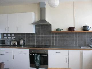 Modern, well equipped kitchen with direct sea views