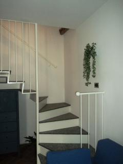 The stair to the second floor as seen from the living room