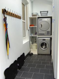 Utility with washing machine, tumble dryer, boot trays, coat hooks and buggy storage...