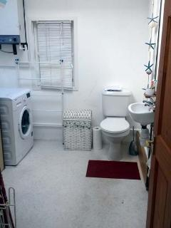 Utility Laundry and downstaires Toilet.