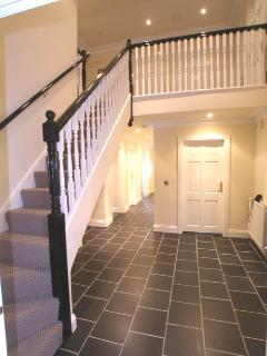 Spacious fully tiled hallways