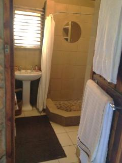 Bathroom - with basin, shower and standard toilet.