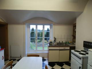 KItchen with room for table in the middle and uplifting view down to the garden.