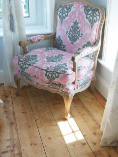Cosy chair in bedroom, with breath taking views out to sea