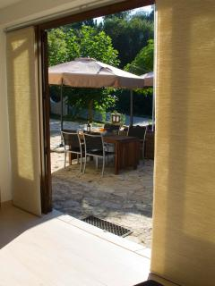 View from the livingroom unto the spacious terrace, floor heating.
