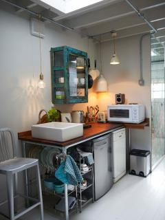 The integral kitchen enables guests to enjoy their own food with complimentary teas and nespressos.