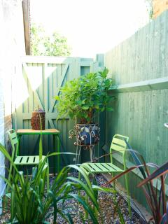 A compact private patio has been set aside for guests to relax outside. Feel free to smoke here