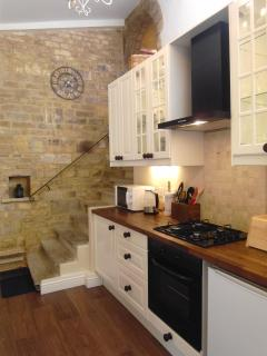 Fantastic large kitchen with stone steps up to roof terrace