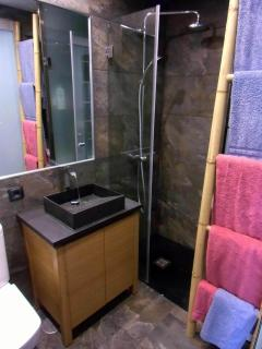 Japanese cabinet, natural stone surface, waterfall faucet
