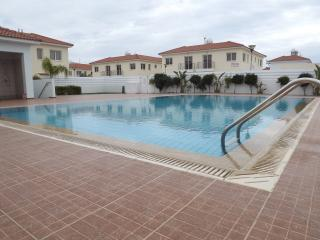 Large communal pool with shower rooms and sun loungers.