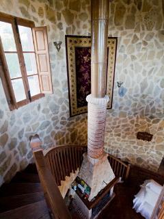 Sweeping staircase up top Mezzanine balcony.