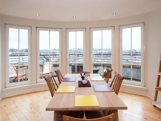 The dining table seats six. Dine with gorgeous 180 degree views from the dining area and balcony