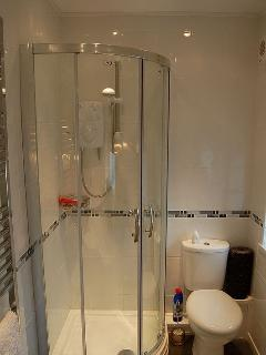 Lovely bathroom with glass shower screen