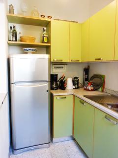 Kitchen with sink, fridge, oven, dishwasher